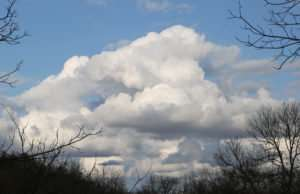Ozark Sky in March photo by Gail E Rowley clouds in Ozarks over creek valley